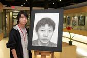 "Son Tran, 2012.  Winner of the 2010 Scholastic Gold Key Award and the Young Artist Award.<br/>Charcoal pencil drawing of self-portrait, ""Place Creative Title Here""."