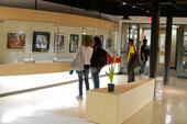Students mingle in the art gallery at passing time.