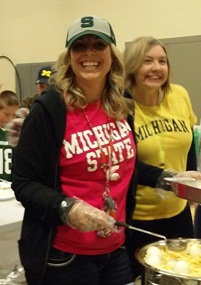 A few of the teachers are smiling while helping with breakfast!