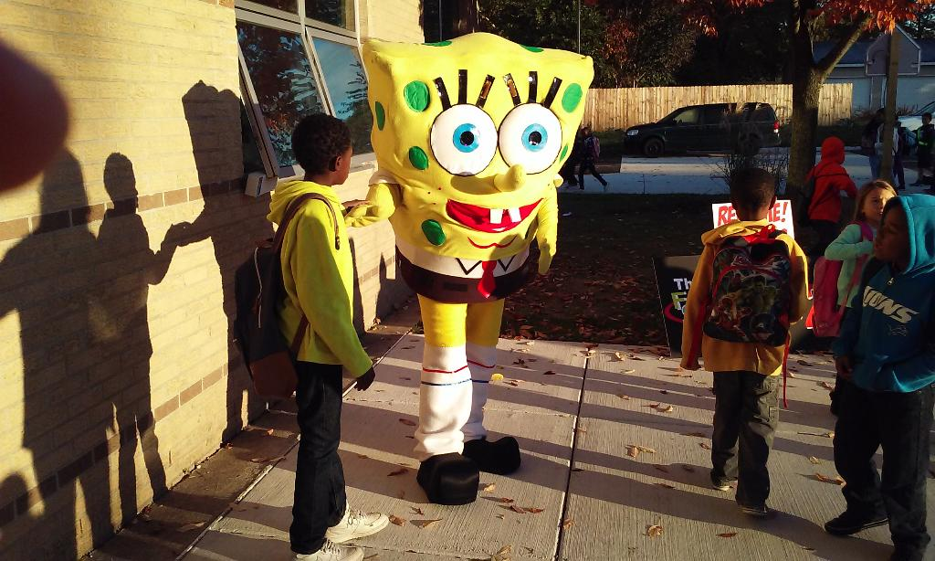 SpongeBob SquarePants makes an appearance! He stands with a few students.