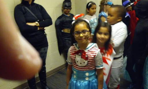 Students walk around the school, showing off their wonderful costumes! At the front we have a Hello Kitty Sailor!