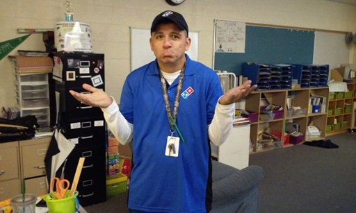 Mr. Garay, our 3rd grade teacher, pouts while wearing a Domino's pizza outfit. Not quite the domino outfit the rest of the staff has in mind.