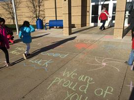 Chalk decorates the entrance of Brookwood, cheering on th 5th graders for M-Step!