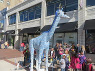 The students take a good look at a giraffe sculpture.