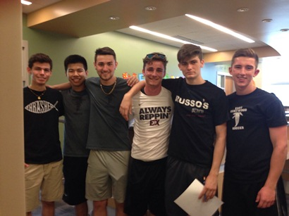 The six varsity soccer players, pose for a picture.